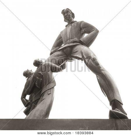 Bronze statue of giant Antigoon, legend of Antwerp, Belgium isolated on white