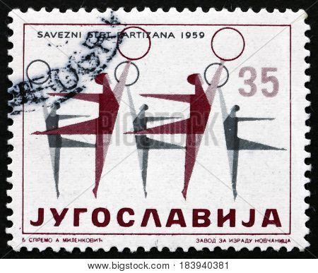 YUGOSLAVIA - CIRCA 1959: a stamp printed in Yugoslavia shows Women Gymnasts Physical Culture Festival circa 1959