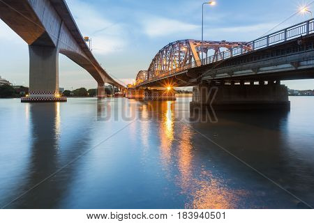 New and Old bridge cross over Bangkok city river cityscape background