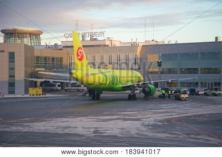 ST. PETERSBURG, RUSSIA - JANUARY 07, 2017: Airbus A320 of S7 Siberia Airlines at Pulkovo Airport in January twilight