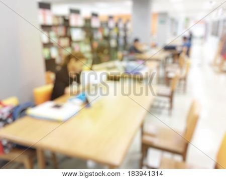blurred university students training / reading / searching for books / and preparing for the final examination in library at university, blur group of asian research/explain/practice homework
