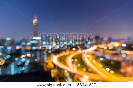 Night blurred bokeh light city and highway abstract background