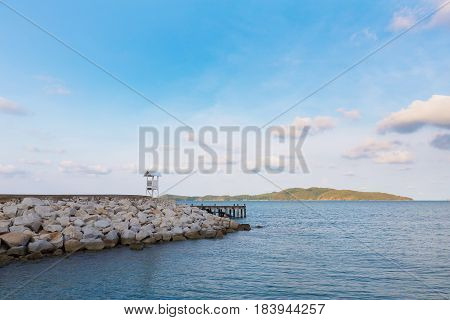 White lifeguard stand on seacoast skyline natural landscape background