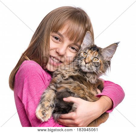 Happy little girl hugging lovely kitten. Cute ten year old child playing with her cat, isolated on white background. Portrait of beautiful kid holding on hands big fluffy Maine Coon kitty.