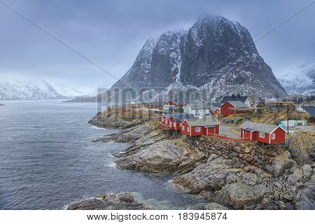 Travel Concepts and Ideas. Traditional Fishing Hut Village in Hamnoy Mountain Peak in Lofoten Islands Norway. Horizontal Image