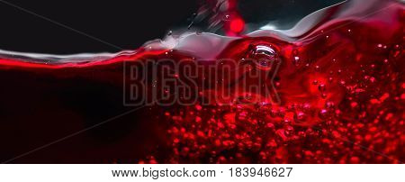 Abstract Splashes Of Red Wine On A Black Background