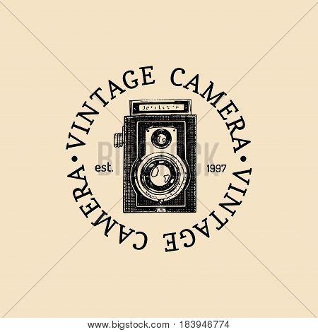 Photography logo. Vector vintage old camera label, badge, emblem. Hand sketched illustration for studio, store etc