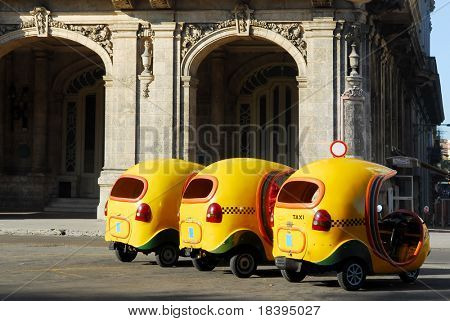 Yellow coco taxi's in the center of Havana, Cuba