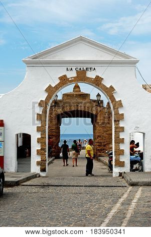 CADIZ, SPAIN - SPETMEBER 8, 2008 - Entrance arch leading to La Caleta beach with the sea to the rear Cadiz Cadiz Province Andalusia Spain Western Europe, September 8, 2008.