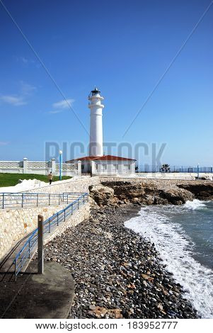 View of the whitewashed lighthouse along the rugged coastline Torrox Costa Malaga Province Andalusia Spain Western Europe.