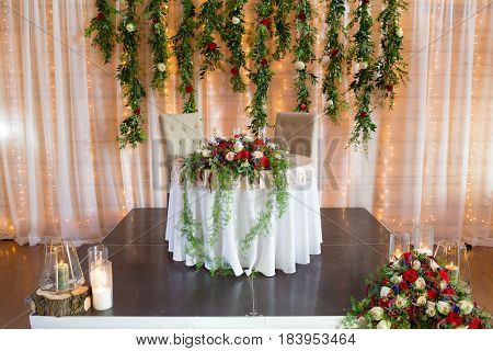 Sweetheart table for the bride and groom at their wedding reception.