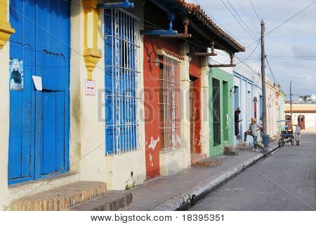 CAMAGUEY, CUBA - CIRCA NOVEMBER 2008 : Colorful street scene in the city of Camaguey, Cuba circa November 2008. The town was designated a UNESCO World Heritage Site in July 2008.