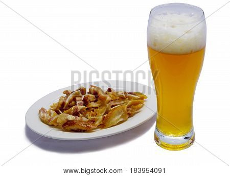 Glass of beer with a smoked pig's ears