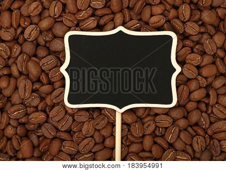 Black Chalkboard Sign Over Roasted Coffee Beans