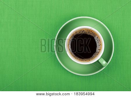 Full Black Coffee In Green Cup Close Up Top View