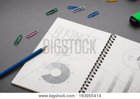 Creative Sketch In Spiral Notepad With Laptop On Desk. Business Starup Plan.