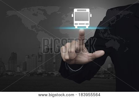 Businessman pressing bus flat icon over dot world map and modern city tower Business transportation service concept Elements of this image furnished by NASA
