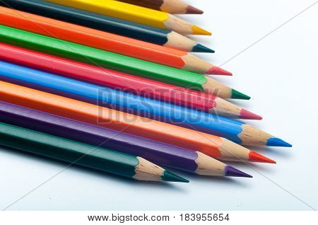 Colored pencils, on a background of white paper with a picture