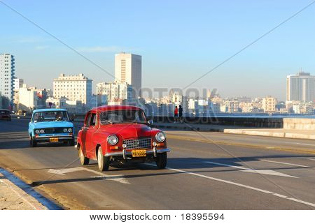 HAVANA - CIRCA DEC 2008: Vintage cars on Macelon boulevard circa December 2008 in Havana, Cuba . The promenade stretches for 8 km along the coast in Havana.