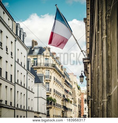 The French Flag Flying In A Residential Street In Paris