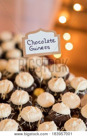 Bakery supplied chocolate guiness flavored tartletts for this wedding reception.