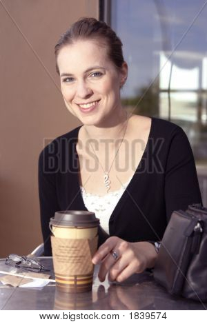 Young Woman Enhoying Her Coffee Or Tea