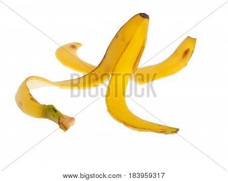Slippery banana skin isolated on a white background
