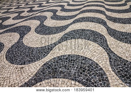 tiled floor. Waves of tiled floor in Portuguese traditional style Rossio square, Lisbon