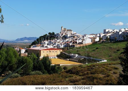 ALOZAINA, SPAIN - OCTOBER 29, 2008 - View of the white town with the church at the top of the hill and a sports centre in the foreground Alozaina Malaga Province Andalusia Spain Western Europe, October 29, 2008.