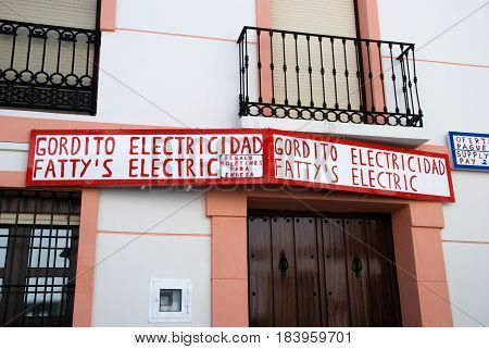 ALOZAINA, SPAIN - OCTOBER 29, 2008 - Fattys Electric shop sign above a doorway Alozaina Malaga Province Andalusia Spain Western Europe, October 29, 2008.