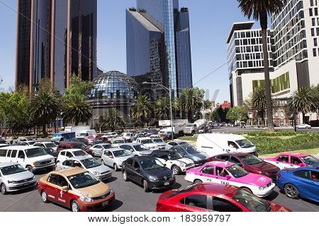 MEXICO CITY, MEXICO - FEB 09, 2017: Traffic stands still at a major Paseo Reforma intersection.