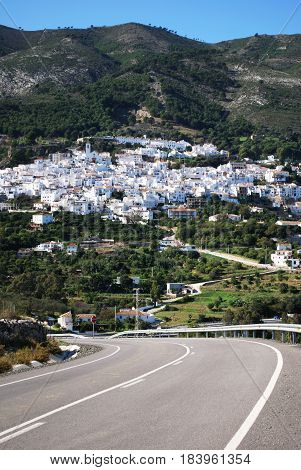 Country road leading to the white village in the Spanish countryside Casarabonela Malaga Province Andalusia Spain Western Europe.