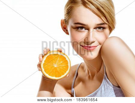 Smiling young girl holding oranges halves on white background. Great food for healthy lifestyle