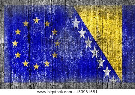 EU and Bosnia and Herzegovina flag on concrete wall
