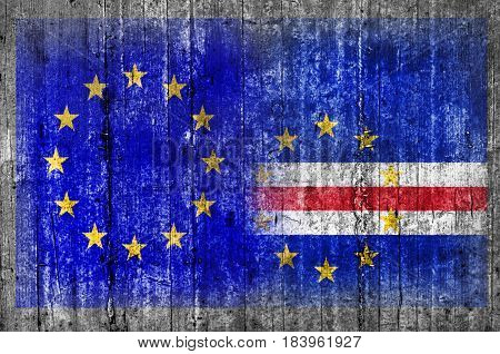 EU and Cape Verde flag on concrete wall