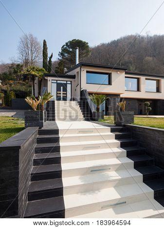 Exterior view of a modern luxury villa, nobody inside