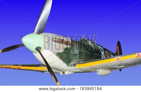 British Spitfire World War Two fighter plane, isolated on faux sky background