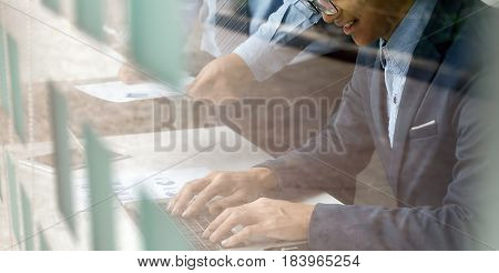 Double exposure photo.Man hand touching modern laptop.Investment manager working new private banking project office.Using electronic device.