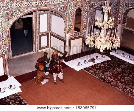 SAMODE, INDIA - NOVEMBER 22, 1993 - Elevated view of a group of Indian musicians performing at the Samode Palace Samode Rajasthan India, November 22, 1993.