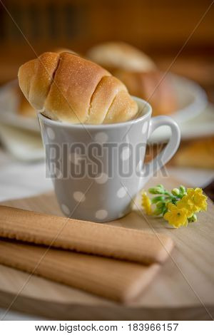 Cup Of Milk An  Dried Little Bun Brioches