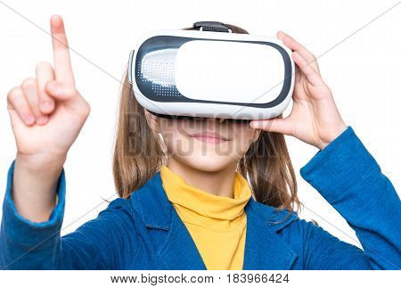 Happy amazed little girl wearing virtual reality goggles watching movies or playing video games. Cheerful surprised child looking in VR glasses and gesturing with his hands.