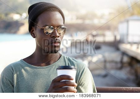 Outdoor Summer Shot Of Handsome Fashionable African American Male Hipster Feeling Relaxed And Carefr