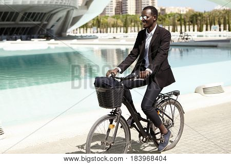 Environmentally Friendly Afro American Banker In Formal Wear And Shades Looking Happy And Relaxed, C