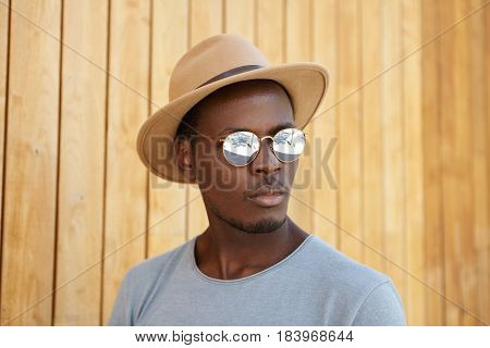 People, Style And Fashion Concept. Trendy Looking Fashionable Young Afro American Male Model Wearing