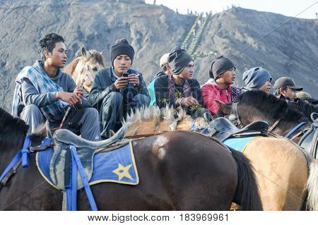 Horse Riders Smoking Cigarettes On Mt.bromo National Park