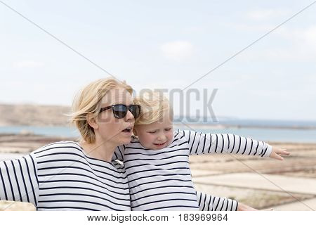 Woman And Little Girl In Matching Outfits In Bright Outdoors