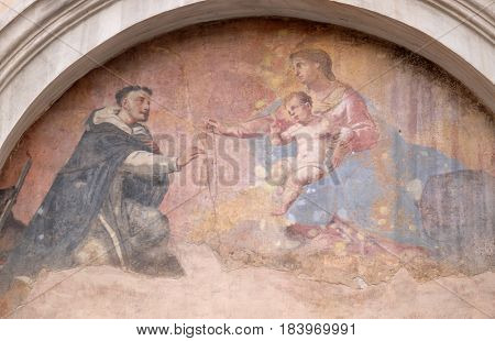 ROME, ITALY - SEPTEMBER 01: Fresco of Our Lady with Child Jesus and Saint Dominic, tympani over the side entrance of Basilica Santa Maria Sopra Minerva, Rome, Italy on September 01, 2016.