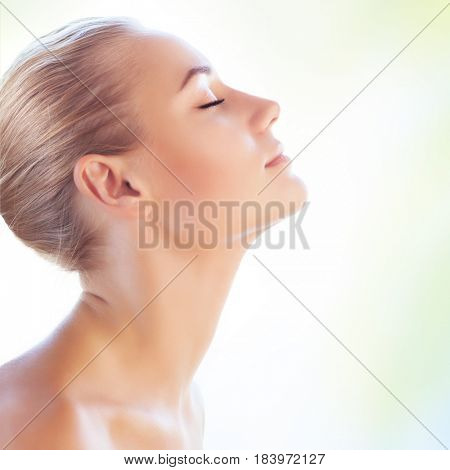 Profile portrait of a beautiful blond girl with closed eyes isolated on clear background, perfect clean skin, natural makeup, authentic beauty, health care and day spa