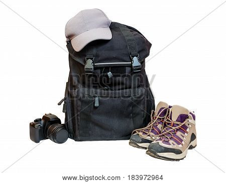 Backpack cap camera and shoes backpackers isolated on white background