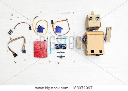 Robot and robotics parts and elements on desktop. flat lay